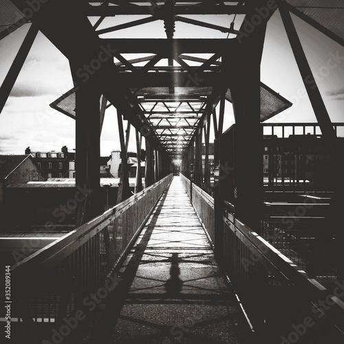 Canvastavla Shadow Of Grille On Footbridge