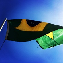 Low Angle View Of Brazilian Flag Against Sky
