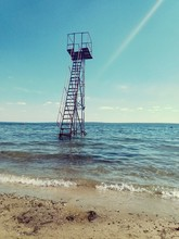 Rescue Tower In Sea Against Sky