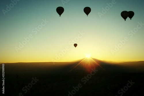 Canvastavla Silhouette Hot Air Balloons Over Landscape Against Clear Sky During Sunset