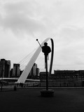 Low Angle View Of Gateshead Millennium Bridge Against Sky In City
