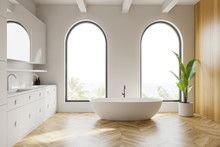 Arched White And Wooden Bathro...