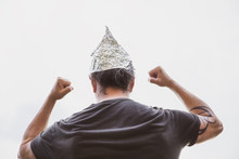 Man With A Tin Foil Hat On His...