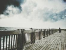 Wooden Sidewalk At Sea Against...