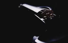 Close-up Of Violin In Darkroom