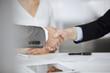 Leinwandbild Motiv Business people shaking hands finishing contract signing, close-up. Business communication concept. Handshake and marketing
