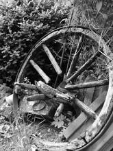 Close-up Of Broken Wheel On Field