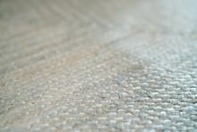 Pale Jute Floor Rag Background Closeup