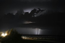 Thunderstorm In Cloudy Sky At Night
