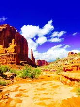 Rock Formations Against Sky At Arches National Park On Sunny Day