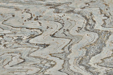White Rock Background With Dark Lines The Texture Stone With A Wavy Pattern.