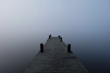 Wooden Pier On Lake During Foggy Weather
