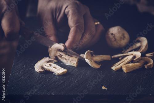 Photo Cropped Image Of Chef Cutting Mushroom