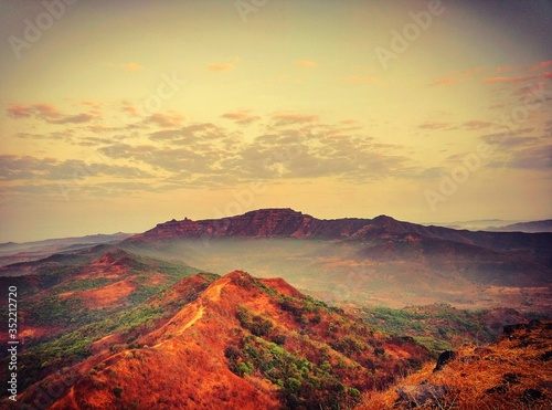 Scenic View Of Landscape Against Cloudy Sky #352212720