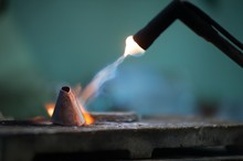Close-up Of Burning Metal With Welding Torch