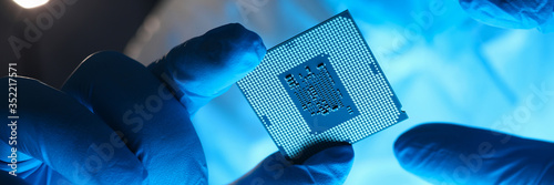 Fototapeta Hands in gloves hold chip testing microelectronics