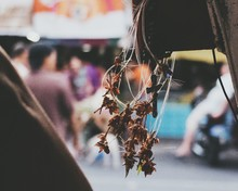 Rosary Beads With Dry Flowers Hanging On Metal