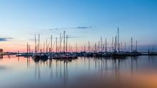 Sailboats Moored In Harbor Aga...