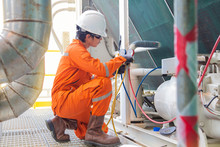 An Electrician Checking Pressure Of Building Heating Ventilation Air Condition (HVAC) System For Maintenance Service At Offshore Accommodation.
