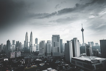 Kuala Lumpur Tower And Petronas Towers In City Against Sky During Dusk