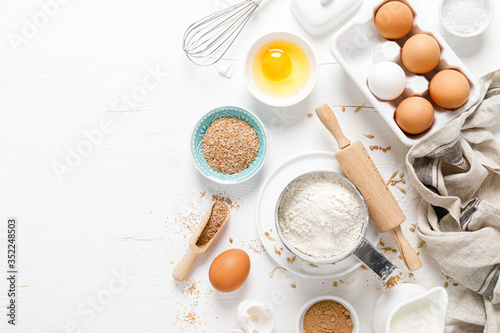 Tela Baking homemade bread on white kitchen worktop with ingredients for cooking, cul
