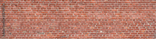 Panorama of an old red brick wall as a background or texture