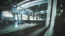 Railroad Station Platform Seen From Wet Train Window