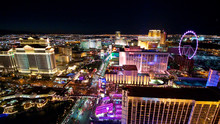 Aerial Panorama Of Las Vegas Strip By Night. Scenic Flight Over High Roller, Caesars Palace, The Paris, Planet Hollywood, Bellagio Casino And Hotel