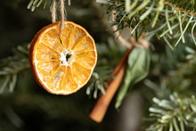 Zero Waste Christmas Concept. Christmas Tree Decorated With Ornaments Made Of Natural Materials - Slice Of Dried Orange And Cinnamon Stick, Close-up