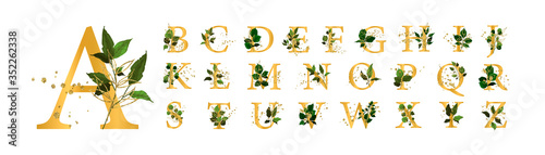 Fototapeta Gold floral alphabet font uppercase letters with flowers leaves and gold splatters for wedding invite card and logo. Vector illustration for greeting card template design obraz na płótnie