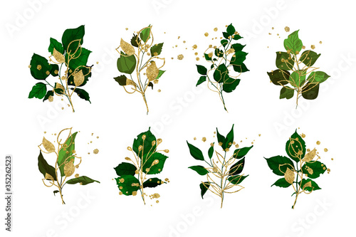 Fototapeta Gold leaves green tropical branch plants wedding bouquet with golden splatters isolated