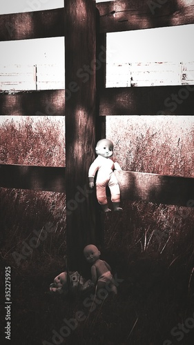 Fotografering Abandoned Dolls At Wooden Fence
