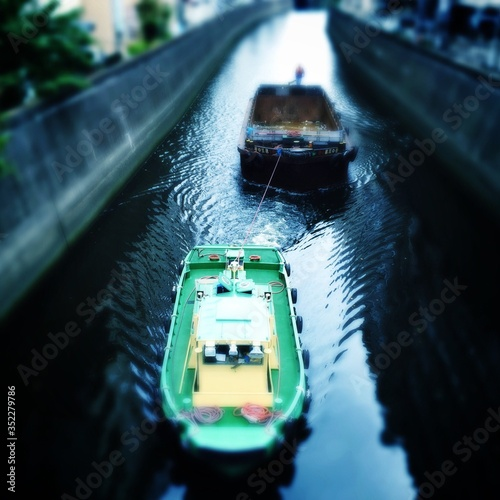Fényképezés Tugboat Pulling Barge In Canal