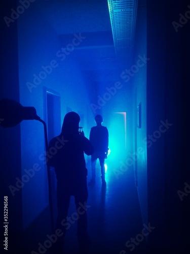 Man Taking Photo Of Friend In Blue Light
