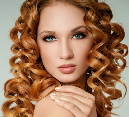 Fototapeta Do fryzjera Portrait of woman with long curly beautiful red hair. Long Curly Red Hair. Fashion Woman Portrait