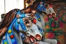 Close-up Of Carousel Horses At Amusement Park