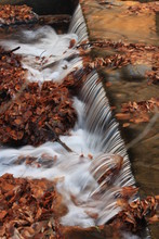 Close-up Of Waterfall In River