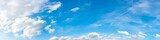 Fototapeta Na sufit - Panorama of a blue sky with white clouds as a backround