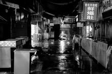 Wet Road Amidst Buildings