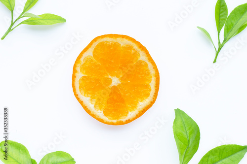 Fresh orange citrus fruit with leaves on white background. Juicy, sweet and high vitamin C