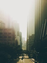 Empty Road Along Tall Buildings