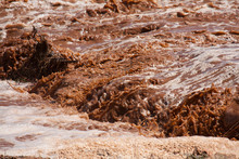 Close-up Of Flowing Muddy Water