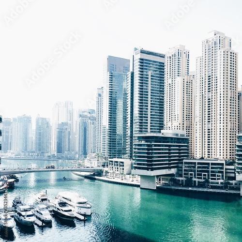 Canal By Modern Buildings At Dubai Marina Fotobehang