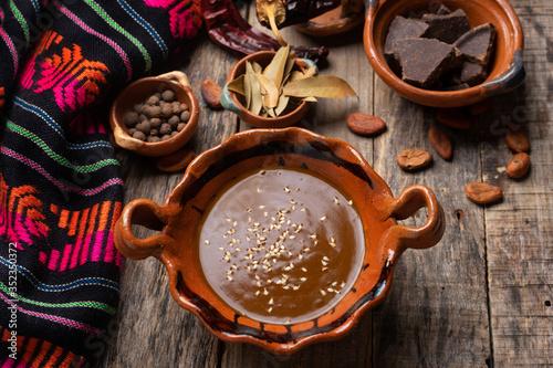 Fototapeta Mexican mole sauce on wooden background obraz