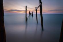 Broken Pier On Sea During Sunset