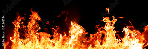 Obraz Panorama Fire flames on black background. fire burst texture for banner backdrop. - fototapety do salonu