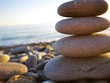 Close-up Of Stones Stacked At Beach Against Sky