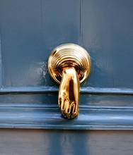 Close-up Of Gold Colored Handle On Blue Wooden Door