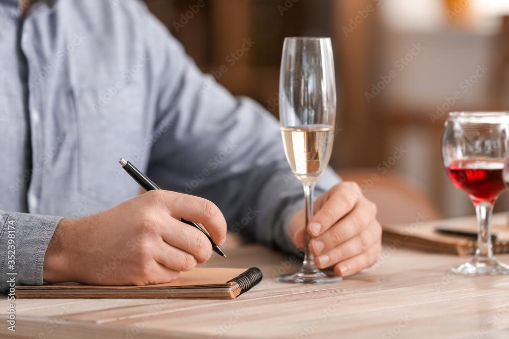 Fototapeta Man tasting wine at the restaurant