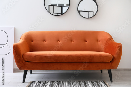 Obraz Interior of room with mirrors and sofa - fototapety do salonu